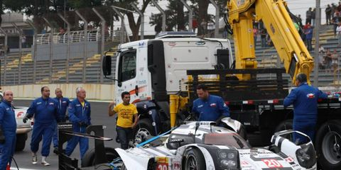 Mark Webber's Porsche 919 Hybrid hits the sideline after hitting the wall in Sao Paulo on Sunday during the World Endurance Championship finale.