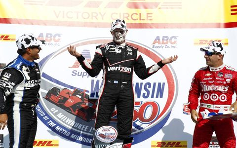 Juan Pablo Montoya, Will Power and Tony Kanaan take a non-traditional pose on the victory podium at Milwaukee on Sunday.