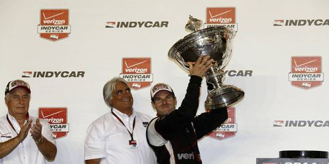Will Power holds up this trophy.