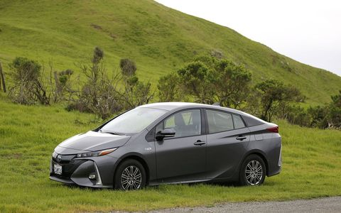 Unseasonably late rains in California made the Sonoma Raceway hills as green as the Prius' public image.