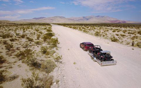 Right off the showroom floor the Chevy Tahoe Custom can tow 6600 pounds. In this case it hauled two Polaris RZR side by sides straight outta Vegas and into the Nevada desert.