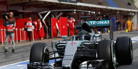 Nico Rosberg, who finished second in the 2014 F1 championship, was quickest in Friday's test session at Barcelona.