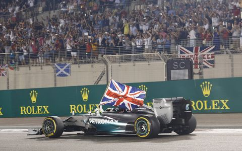 Lewis Hamilton displays a Union Jack as he does a victory lap.