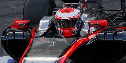Jenson Button's McLaren-Honda completed fewer laps than all but one car during the first day of the Barcelona test on Thursday.
