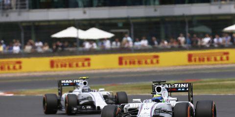 Felipe Massa holds off Williams F1 teammate Valtteri Bottas during the opening laps at Silverstone on Sunday.