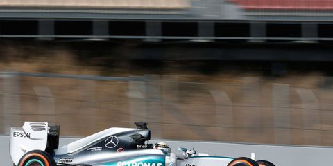 Lewis Hamilton was back in the saddle on Friday after falling ill on Thursday in Barcelona.