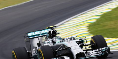 Nico Rosberg edged out teammate Lewis Hamilton in Formula One practice on Saturday in Brazil.