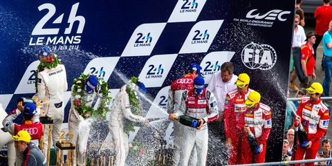 The winning Porsche team celebrates its win at Le Mans on Sunday.