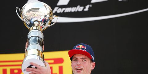 Verstappen proudly hoists the first place trophy on the podium in Spain.