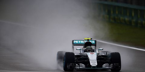 Nico Rosberg won the pole for Sunday's F1 race in China. His Mercedes teammate and rival Lewis Hamilton will start last.