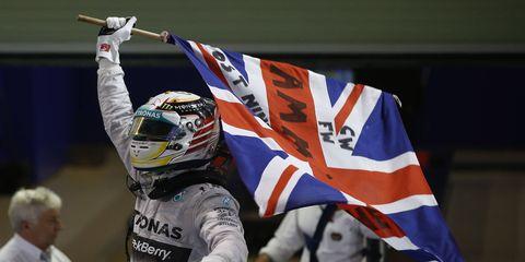 Mercedes driver Lewis Hamilton celebrates after winning Formula One championship.