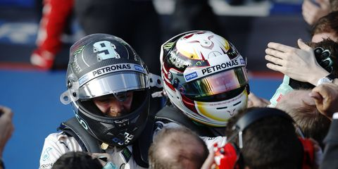 Lewis Hamilton and Mercedes teammate Nico Rosberg celebrate after a one-two finish in Melbourne.