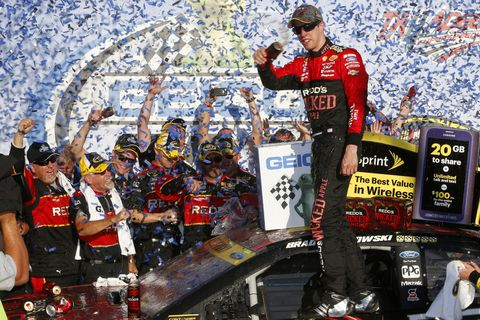 Brad Keselowski celebrates with his crew after winning at Talladega and advancing in the Chase.