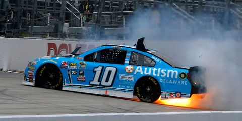 Danica Patrick crashed and her car caught fire early in Friday's practice session at Dover.