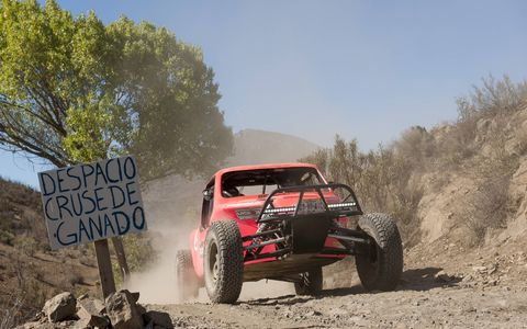 A Baja Challenge buggy crawls up the trail