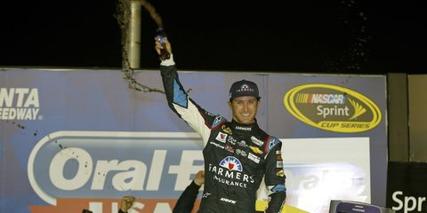 Kasey Kahne secured his first win of the season Sunday night in Atlanta.