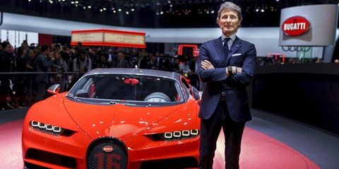 Stephan Winkelmann stands next to one his French company's beautiful, and expensive, creations.