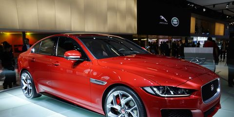The Jaguar XE shows off on its Paris motor show stand.