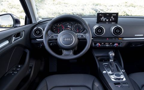 The center stack in the 2015 Audi A3 2.0 TFSI Premium is simplistic with the center control wheel and other knobs.