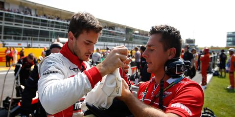 Jules Bianchi, left, gets ready to race at Monza in Italy in 2014.