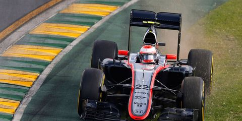 Jenson Button cuts a corner trying to find speed in Melbourne on Saturday.