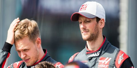 Kevin Magnussen, left, and Romain Grosjean did not finish in the F1 opener in Melbourne.