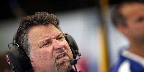 Michael Andretti makes the face that pretty much everyone does when they hear his awful pun.