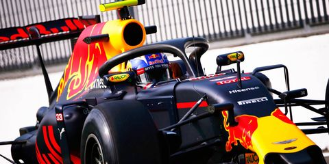 Max Verstappen tests an F1 car equipped with the halo head safety device over the weekend at Monza.