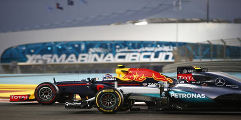Max Verstappen battles with Nico Rosberg at Abu Dhabi.