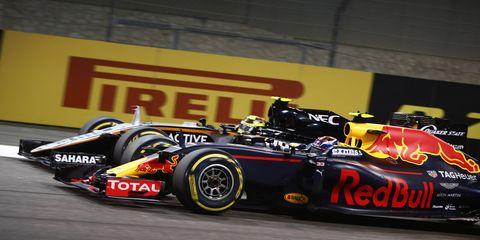 Max Verstappen passes Sergio Perez with his trademark close-quarters style.