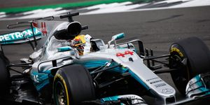 Lewis Hamilton celebrates his fourth straight F1 British GP victory.
