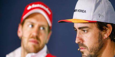 A frustrated Fernando Alonso, right, might have his sights set on a return to Ferrari and ride alongside Sebastian Vettel, left, in 2018.