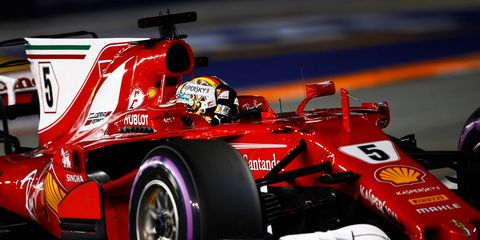 Sebastian Vettel, who won the pole in Singapore on Saturday, trails Lewis Hamilton by just three points in the championship standings.