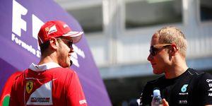 Sebastian Vettel, left, shares time with Mercedes rival Valtteri Bottas.