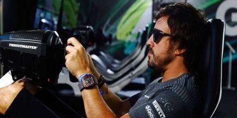 Fernando Alonso tries his hand at a simulator in Baku, Azerbaijan.