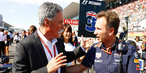 F1 boss Chase Carey, left, and Red Bull's Christian Horner meet on the F1 grid.