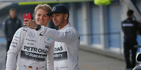Lewis Hamilton, right, hopes to be challenged by drivers other than just teammate Nico Rosberg, left, during the 2015 Formula One season.