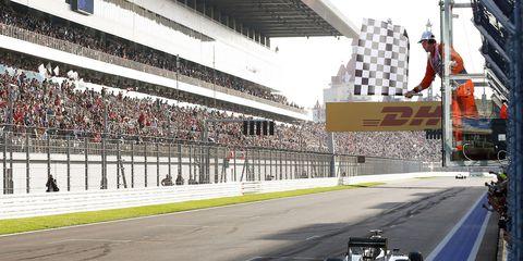 Lewis Hamilton takes the checkered flag at Sochi in 2014.
