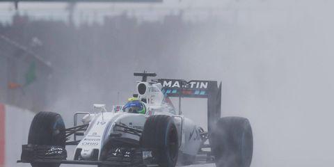 Felipe Massa navigates the wet track during the Formula 1 British Grand Prix.