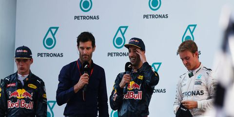 Mark Webber talks to Max Verstappen, Daniel Ricciardo and Nico Rosberg at the Sepang International Circuit in Malaysia.