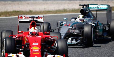 Ferrari's Sebastian Vettel leads Mercedes' Lewis Hamilton in Spain on Sunday. Hamilton went on to finish second and Vettel third behind winner Nico Rosberg.