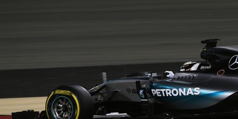 Lewis Hamilton captured the pole for Sunday's Formula One race in Bahrain.