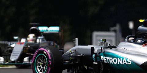 Lewis Hamilton passes the crashed car of Nico Rosberg in Austria.