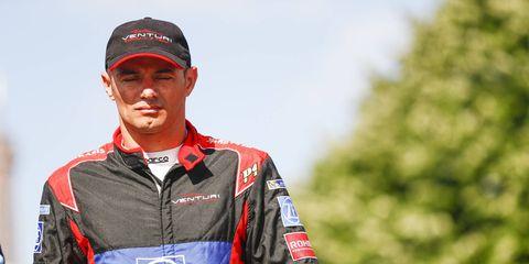 Stéphane Sarrazin walks down the grid in Paris. A driver for the Venturi Formula E team, he was picked up by Techeetah.
