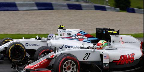 Esteban Gutierrez (21) battles Valtteri Bottas for track position in Austria.