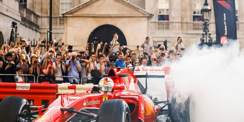 Sebastian Vettel plays to the fans during a promotional event in London on Wednesday.