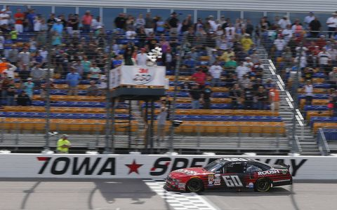 Chris Buescher outran the field to win the NASCAR Xfinity Series race at Iowa Speedway on Sunday.