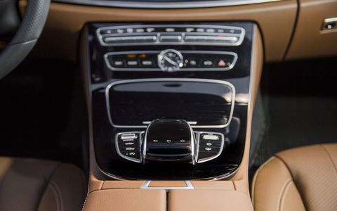 High-quality materials define the E-Class' interior, including leather and natural grain ash with flowing lines.