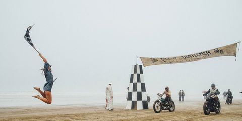 They came to race, and race they did: Cars and bikes faced of on the beach despite a visit from Typhoon Songda.