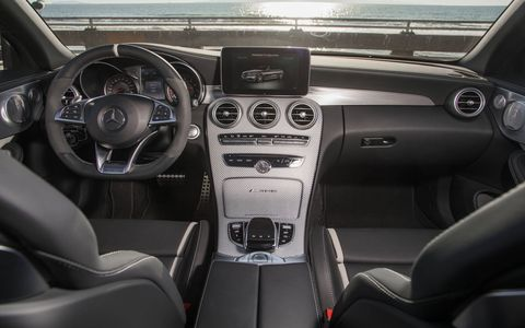 The central touchpad is flanked by the AMG Dynamic Select switch and several AMG-specific controls such as the button for the three-stage AMG Ride Control suspension, three-stage ESP or optionally the button for the AMG Performance Exhaust System.